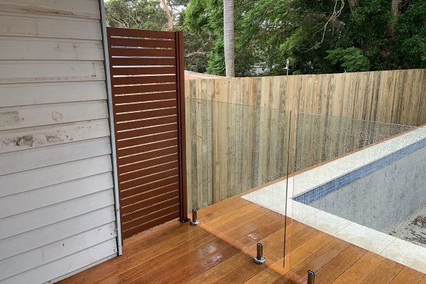 glass pool fence with timber fence central coast